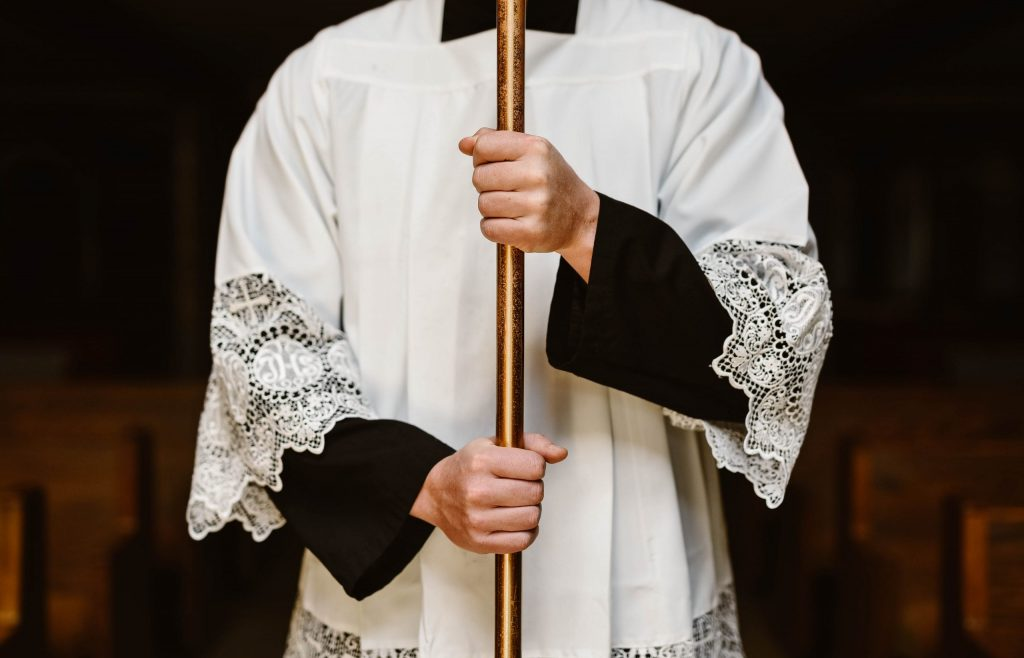 Altar Server holding Cross