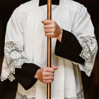Altar Server holding Cross
